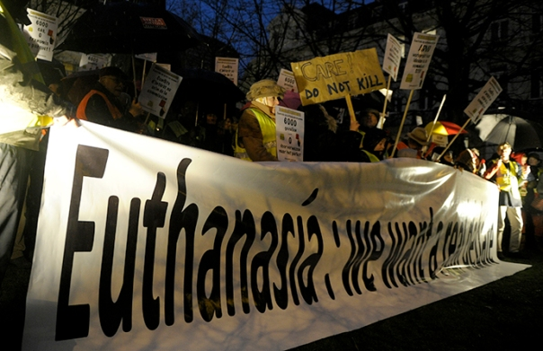 Protesters demonstrate against a new law authorizing euthanasia for children, in Brussels